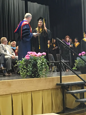 Nicole Schaefer receives a faculty award. Nicole will be pursuing veterinary medicine at the University of Saskatchewan this fall