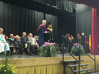 Jerry Wang receives his diploma. Jerry is undecided where he is going -- either McGill or UBC!