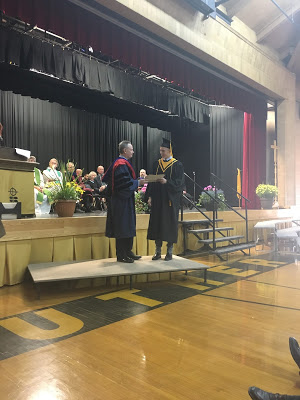 SRC President Brock Lumbard receives the Principal's Gold Medal award. Brock is going to Western university to pursue business and engineering.